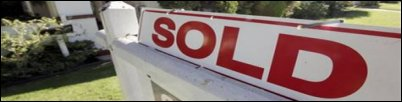 home sales increase sold sign